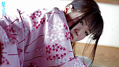 Uri Looking Over Her Shoulder In Pink Floral Yukata