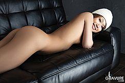 Lying Face Down On The Couch Thighs Pressed Together With Her Ass Raised
