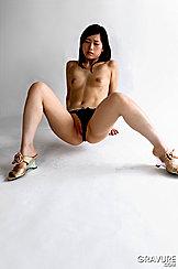 Reika Yamada Sitting Topless In Black Panties And High Heels Baring Small Tits