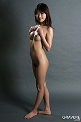 Standing Naked Mana Aoki Has Her Hands Raised Above Her Small Breasts Her Long Hair Falls Down Her Shoulders Bare Feet
