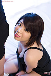 Kneeling In Front Of Man In Shorts Showing Cleavage