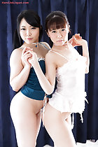 Two girls in lingerie arms raised holding hands