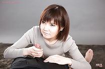 Kosaka Karen stripping and giving handjob tasting cum