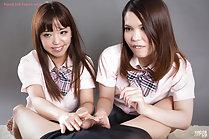 Students Nishino Ena and Momoi Momo giving handjob together