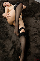 Stretching Out On Floor Hand On Her Thigh Bare Breast Wearing Stockings