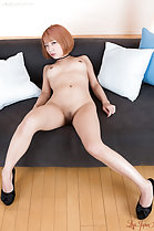 Seated nude on sofa short hair small breasts shaved pussy in high heels