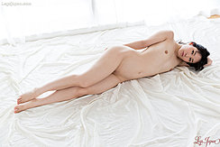 Yui Kasugano Lying On Her Side Nude Small Tits Shaved Pussy Bare Feet