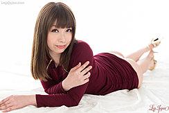 Lying On Her Front Skirt Raised Revealing Her Panties Wearing High Heels