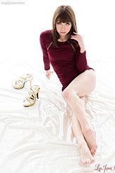 Seated Wearing Scarlet Dress Bare Feet