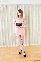 Standing With Legs Crossed Wearing High Heels