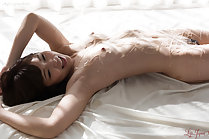 Shino Aoi lying on her back naked covered with oil