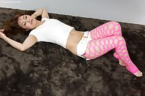 Lying on her back knees drawn up pink pantyhose