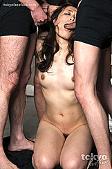 Kneeling Between Two Men Sucking Cock Long Hair Down To Her Small Breasts Hint Of Black Bush Between Her Closed Thighs