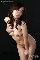 Hirako Saori posing nude long hair leaning forward hand on small breasts pussy hair thighs pressed together