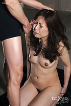 Kneeling nude eyes closed man cumming on her face long hair