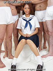 Kogal Sitting Between Group Of Half Naked Men Wearing Uniform Hands Clasped Together On Her Lap Wearing Shoes And Socks