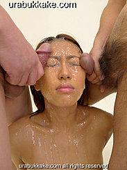 Two Naked Men Rubbing Their Hard Cocks Against Her Bukkake Covered Face