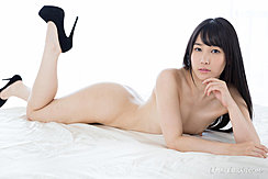 Lying Naked On Her Front Nice Ass Long Hair Wearing High Heels