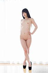 Standing Naked With Hand On Hip Small Breasts Shaved Pussy Wearing High Heels