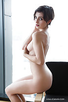 Sitting on chair arm naked