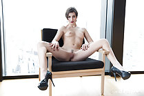 Naked on chair small breasts legs spread pussy exposed high heels