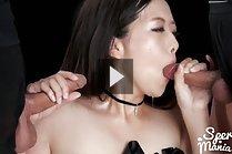 Fukatsu Miyuki on her knees sucking two cocks
